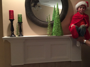 Grandson Gage being our Elf on the shelf