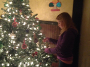 Jayden loving her tree decorating!