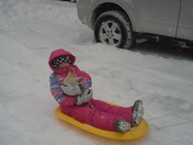 Miss Olivia sledding with a friend