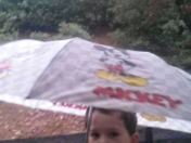 My son gage  playing  in  the  rain