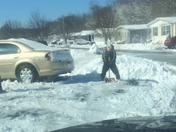 Funny kid humps to shovel snow