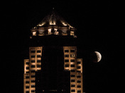 Eclipsed moon passing 801 Grand