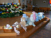 Easter Bunny attends Easter basket blessing at St. Angela Merici in White Oak.