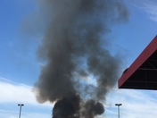 Brush fire at Johnson Creek Outlet Mall