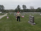 Placing flags on vets graves in Belmont, NH