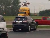 Helicopter leaving Touch A Truck at Quaker Steak