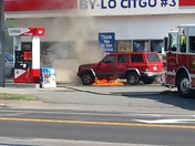 Car on fire at Gas Station