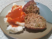 Green chile meatloaf with mashed potatoes and red chili
