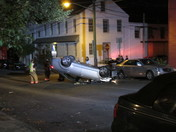 Car flips over on Mulberry Street