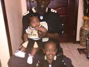 Taylor cheering for the Saints,with her brother Caiden and Great Uncle Mike.
