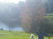 Silas and his puppy, Lyric, enjoying a beautiful Fall day!