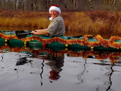 CRAIG WASHBURN IN CHRISTMAS PARADE IN KAYAK IN CONWAY, NH