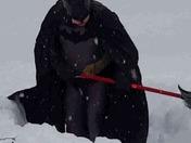 Batman shoveling snow