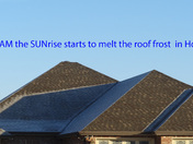 frost starting to melt on roof at sunrise in Houma on 01-24-2016