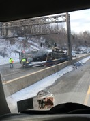 truck rolled on its side and caught fire