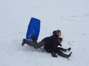 teenagers getting dumped off the sled