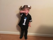 2 year old Sydney of Clinton dabbing with her Cam Newton jersey on