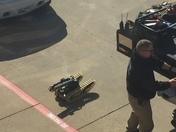 Duffle bag under van at Benton County Administration parking lot