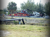 Fla.Tpk. multi car truck accident.  Heavy Equipment transport