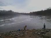 Fishermen on the spillway
