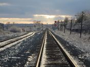 Train tracks at sunset  after Good Friday's ice storm.