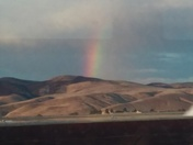 early one morning and rainbow over the hills