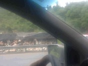 Traveling down rout 30 west and saw a turned over truck