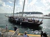 Replica racing yacht America sails into Hull Harbor past Peddocks island