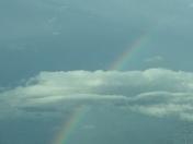 Rainbow through cloud