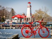 The red bike by the red light house
