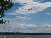 Courtesy Sue Duquette, Peru, NY. KITE SURFING ON CUMBERLAND HEAD BEACH