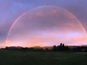 Rainbow at dusk on peaks
