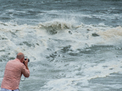 Man watches and photographs tropical storm Hermines in Gloucester, MA