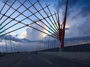 Storm clouds through Iowa bridge art