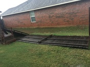 Fence down in Moore