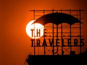 Sunset against Travelers Sign