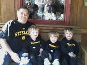 Triplet steelers fans and dad.