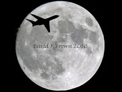 Image of Super Moon with silhouette of jet