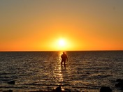 Sunset fisherman silhouette