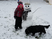 Sophia and Snoopy with our first snowman