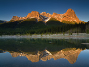 Alpine Glow reflections in the Quarry Lake, Canmore