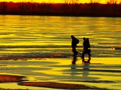 Ice fishermen at lake Manawa tonight