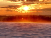Snow mist in the sunset