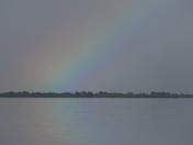 Rainbow with reflection this morning on the Banana River