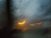 Street light reflecting on a foggy morning.