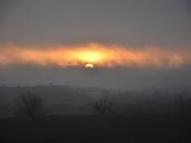 Interesting sunrise through the fog this morning west of Indianola