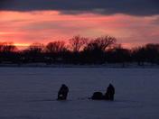 ice fishing at sunset on lake Manawa