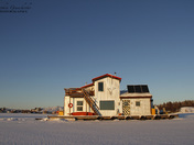Beautiful houseboat on Yellowknife Bay in Great Slave Lake