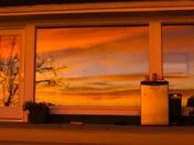 Sunrise in picture window