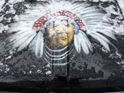 Snow melting on American Indian truck hood mural.